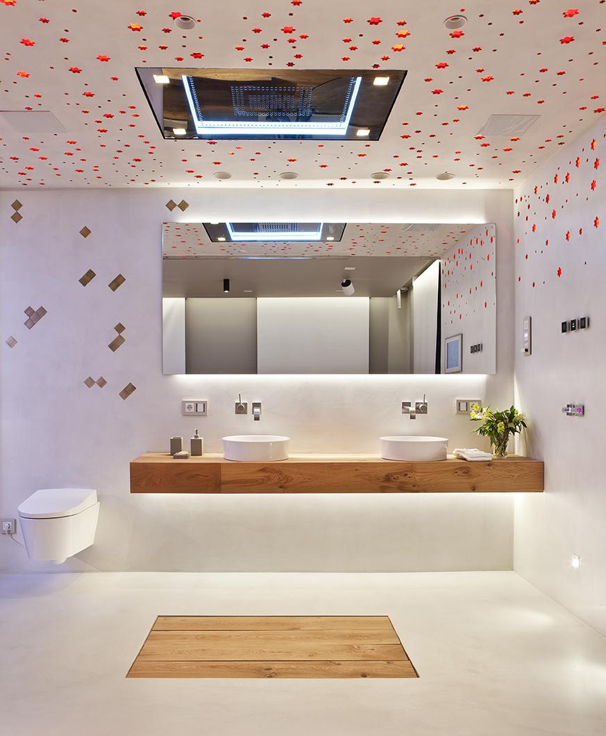 Dormitorio y baño en espacio diáfano